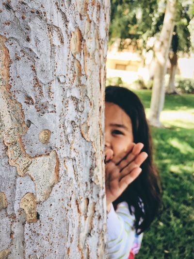 [ Peekaboo... I see you🙈🐵 ] People Watching Hugging A Tree Minimalist Photography  VSCO Point And Shoot Aesthetics IPhoneography Analogue Photography Minimalmood Analog Vintage The Street Photographer - 2016 EyeEm Awards Street Photography Trees People Photography The Places I've Been Today Beauty In Nature Portrait Of A Friend Portrait Photography Girl Power Outdoor Pictures Simple Photography Children Photography Childhood Memories Children's Portraits