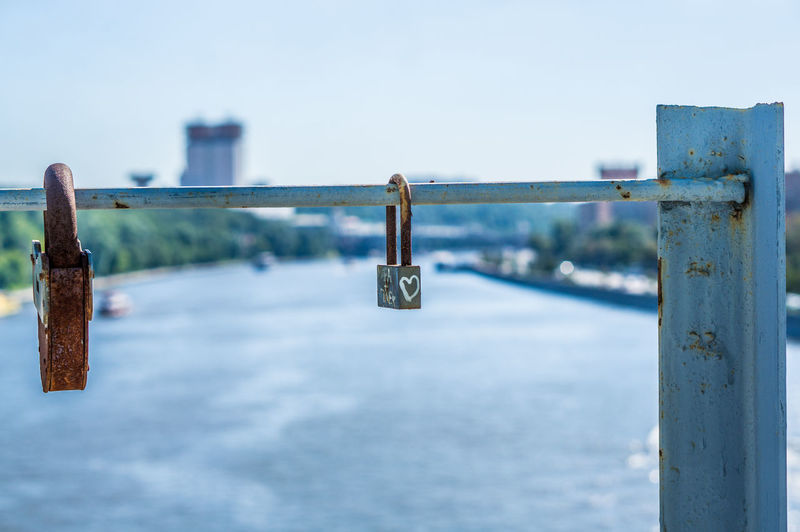 Padlocks Hanging On Railing Of Bridge