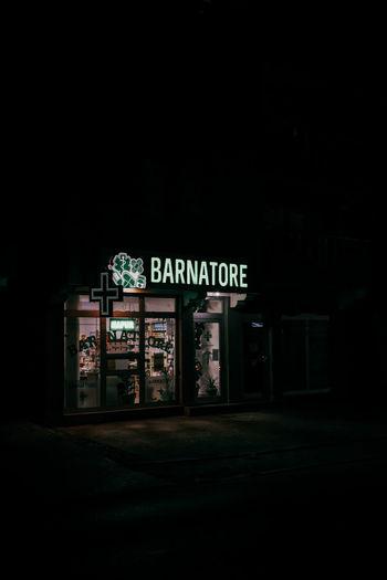 Information sign on illuminated building at night