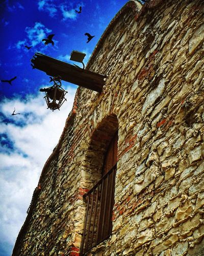 Low Angle View Sky Building Exterior Built Structure Architecture Cloud - Sky No People Outdoors Day Nature Sculpture EyeEmNewHere Dramatic Scenics EyeEm Best Shots Eyeemphotography California Losangeles SoCal Mission Mission Mystery Bird Dramatic Sky Dramatic Angles Brick Wall The Architect - 2017 EyeEm Awards