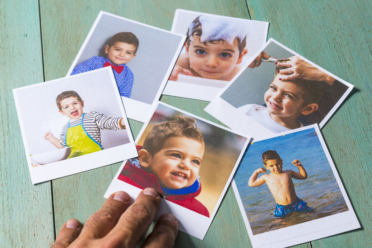 Group of photographies Boys Child Childhood Group Of People Happiness Headshot High Angle View Holding Indoors  Leisure Activity Looking At Camera Males  Men Offspring People Photography Photography Themes Portrait Real People Smiling Table