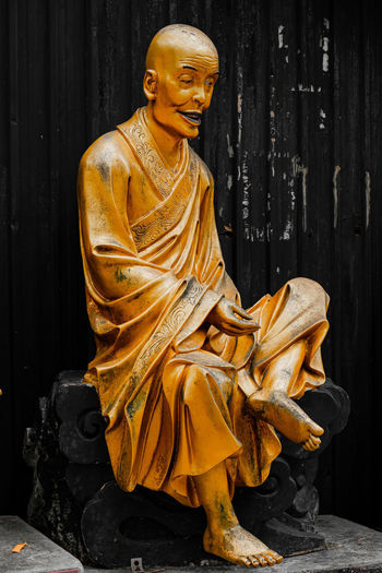 Sculpture of buddha statue outside temple