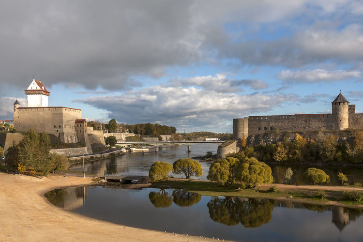Estonia, Narva Ancient Civilization Architecture Building Exterior Built Structure Castle Cityscape Cloud Cloud - Sky Cloudy Community Culture Estonia Famous Place History Narva Outdoors River Sky Town TOWNSCAPE Water Waterfront