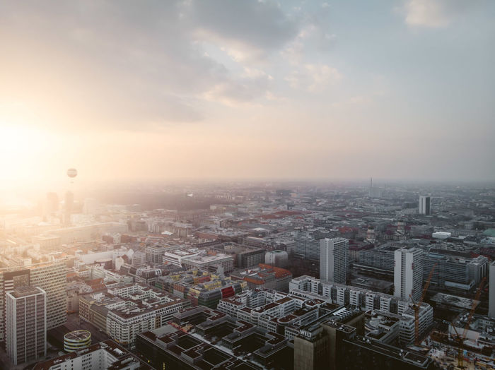 Berlin Mitte DJI X Eyeem From Above  Hope Aerial View Architecture Balloon Building Built Structure City Cityscape Clouds Day Dronephotography High Angle View Office Building Exterior Pollution Residential District Skyscraper Sun Sun Flare Sun Flares Sunrise Sunset Warm Light
