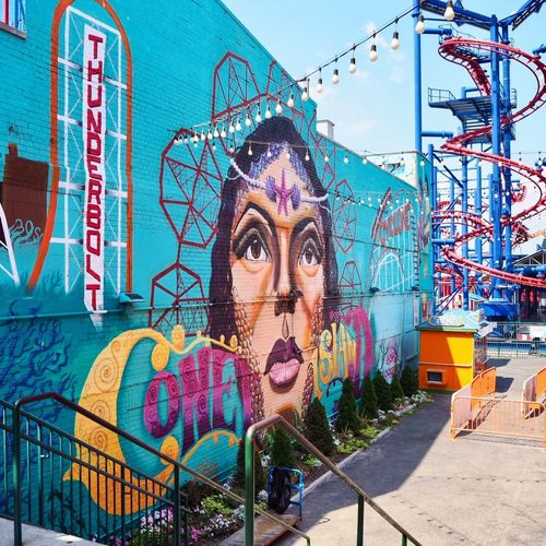 Rollercoaster Lunapark Rollercoaster Coney Island New York City Portrait One Person Young Adult Day Amusement Park Leisure Activity Headshot Arts Culture And Entertainment Built Structure Graffiti