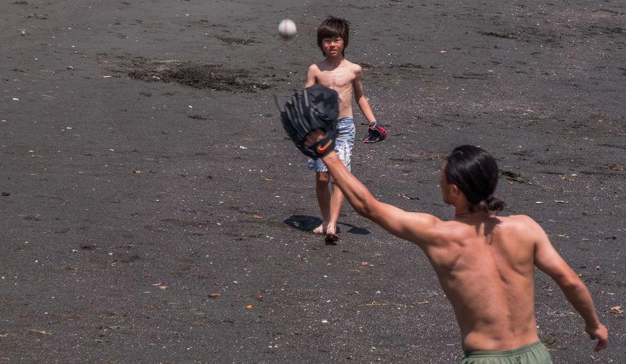 Full length of shirtless boy on sea shore