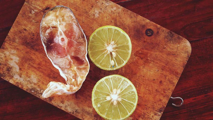 High angle view of lemon slice on cutting board