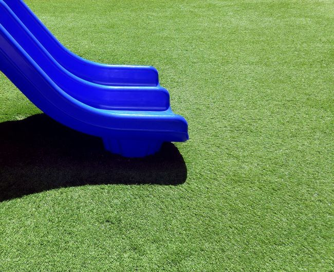 High Angle View Of Blue Slide In Park