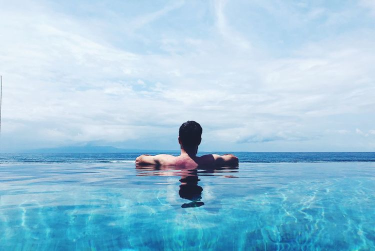 Water One Person Sky Cloud - Sky Sea Waterfront Real People Lifestyles Nature Swimming Day Leisure Activity Beauty In Nature Vacations Swimming Pool Trip Holiday Men Horizon Over Water Outdoors