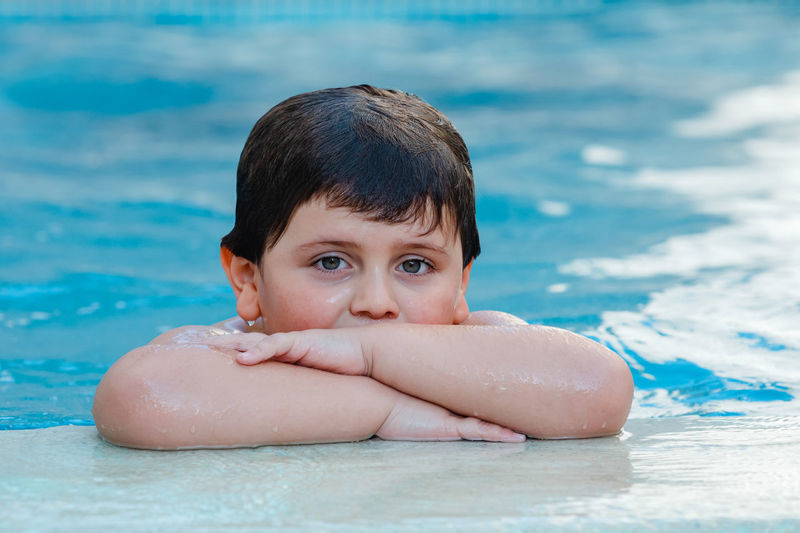 Portrait of shirtless boy in swimming pool