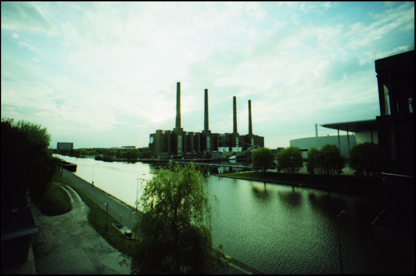 The Iconic Factory of Volkswagen in Wolfsburg 35 Mm Analogue Photography Architecture Autoindustrie Chimneys Factory And Lake Factory And Nature Four Chimneys Iconic Chimneys Tor 17 Volkswagen Diesel Volkswagen Factory Volkswagen Fraud Volkswagen Wolfsburg Wolfsburg Car Industry Diesel Cars Diesel Crisis Factory Factory Chimneys Iconic Buildings Phæno Tunnel Volkswagen Wolfsburgphaeno