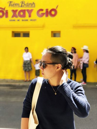 Yellow Potrait Real People Incidental People Built Structure Focus On Foreground Street One Person Architecture Lifestyles People Standing