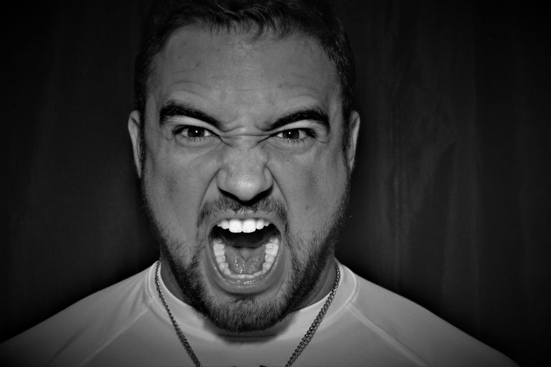 Portrait Looking At Camera One Person Mid Adult Headshot Studio Shot Real People Happiness Angry Close-up Indoors  One Man Only Young Adult Black Background Scream Yelling Mean Resist The Portraitist - 2017 EyeEm Awards Inner Power The Portraitist - 2018 EyeEm Awards