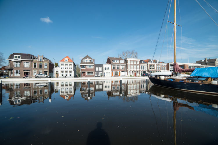 Reflections @ Gouda (1) Architecture Building Exterior Water Built Structure Nautical Vessel Transportation Mode Of Transportation Sky Reflection Moored Sailboat Harbor Waterfront Nature City Mast Building Day Residential District No People Canal Outdoors Marina