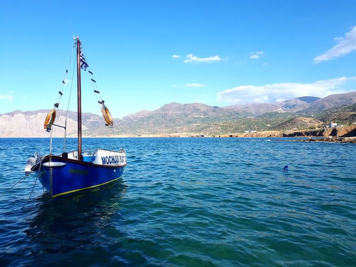 Water Blue Sea Mountain Day Nature Sky Cloud - Sky Outdoors Scenics Nautical Vessel Beauty In Nature boat No People