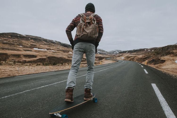 Man skateboarding on highway
