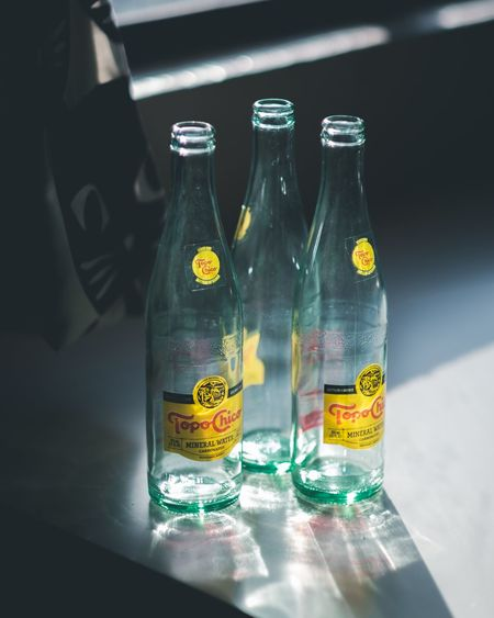 Close-up of glass bottles on table
