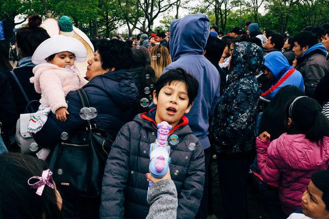 Kids Playing during a Cinco de Mayo celebration. Sunset Park, New York, 2017 #EyeEmNewHere Boys Brooklyn Bubble Gun Bubbles Childhood Cinco De Mayo Cincodemayo EyeEmNewHere Kids New York Playing Streetphotography Sunset Park