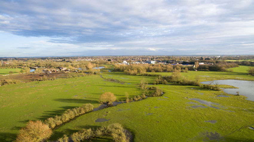 Aerial view over and around a lake also river at early everning in Leicester in the UK. Aerial View Blue Sky White Clouds Bushes Daytime Dronephotography Green Grass 🌱 Lake View Oudoors Outside Photography River View Rural Scene Sunset Trees And Nature Water