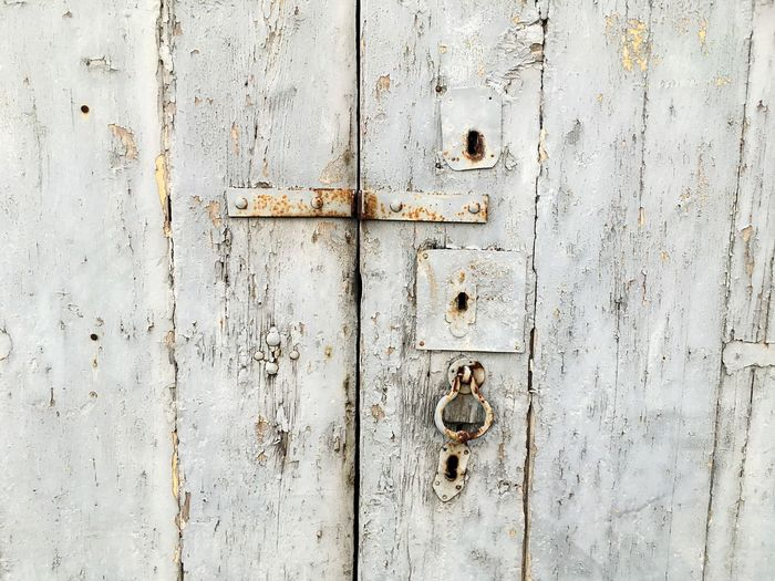 Close-Up Of Damaged Wooden Door
