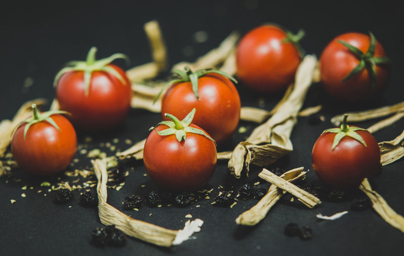 Close-up of tomatoes and black background