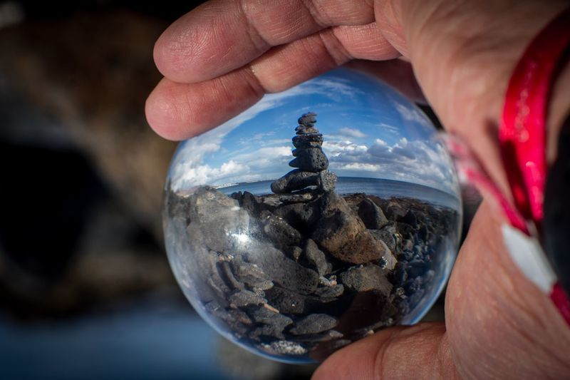 Hold he zen Authentic Arts Ronny Best Pictures Atlantic Coast Stone Art Stones Human Body Part Human Hand Holding Hand One Person Body Part Human Finger Finger Close-up Focus On Foreground Lifestyles Glass - Material Personal Perspective