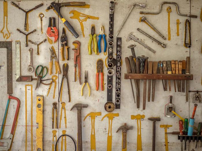 Various tools on wall at workshop