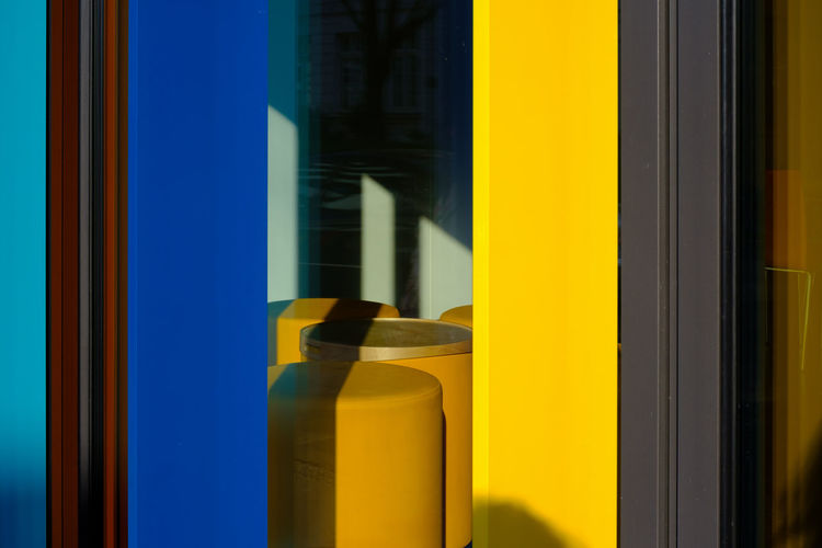 VERTICAL No People Yellow Close-up Architecture Built Structure Window Day Wall - Building Feature Seat Chair Glass - Material Transparent Blurred Motion Outdoors Motion Reflection Door