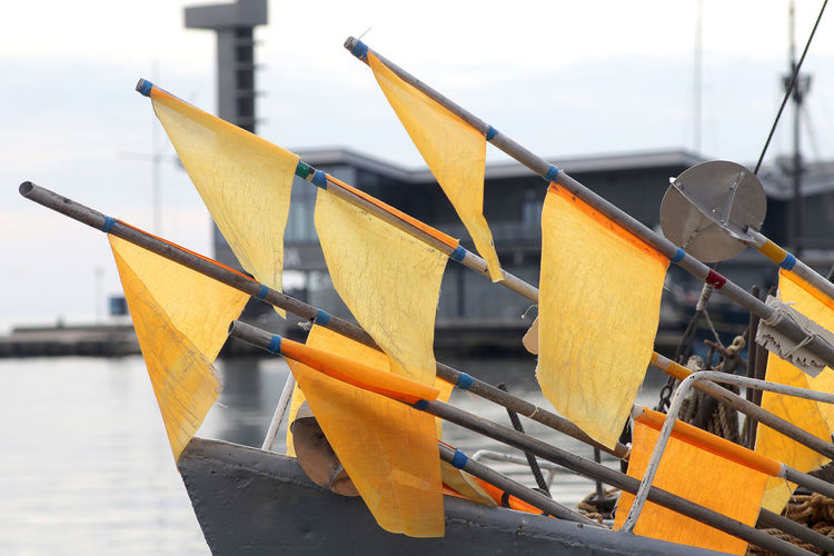 Close-up of yellow boat moored in water