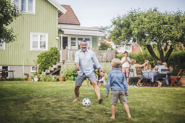 Children playing with ball in yard