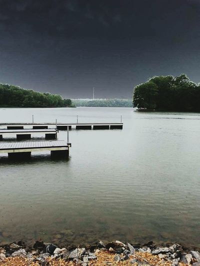 Relaxing Beaitiful Moment Storm Coming Lake Happiness Calmness Boat Dock Trees Cloudy Trees In The Distance Skyscape Docks Rocks Ameturephotography Dark Clouds