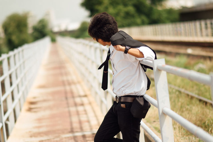 Businessman standing on footbridge