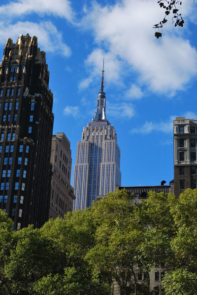New York City Landmark Architecture Blue Building Building Exterior Built Structure City Cloud - Sky Day Financial District  Low Angle View Modern Nature No People Office Building Exterior Outdoors Plant Sky Skyscraper Spire  Tall - High Tower Travel Destinations Tree