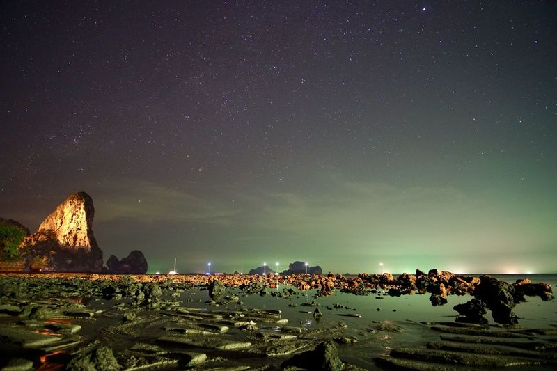 Astronomy Beauty In Nature Illuminated Mountain Nature Night Outdoors People Real People Scenics Sea Sky Star - Space Thailand Tonsai Beach, Thailand Water Women