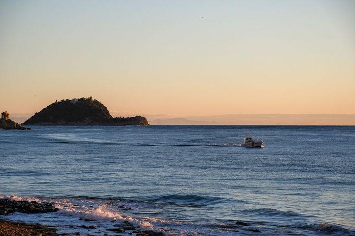 sunrise on sea, with boat Sunrise Sea Sunrise Boat Beauty In Nature Seascape Traveling Travel Destinations Tranquil Scene Island Isle Sunset Sunrise Travel