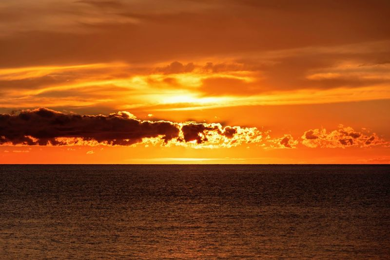 sunset in sant elm, majorca, spain Sunset Sky Cloud - Sky Beauty In Nature Orange Color Scenics - Nature Water Sea Nature Horizon Tranquility Yellow Dramatic Sky Tranquil Scene Idyllic Horizon Over Water Sunlight No People Environment Atmosphere Outdoors Abstract