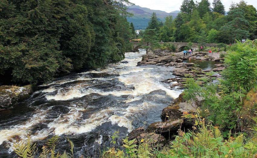 Falls of Dochart Killin  River Dochart Scotland Trossachs National Park Beauty In Nature Falls Landscape Mountain Outdoors People River Rocks Sky Tree Water Waterfall