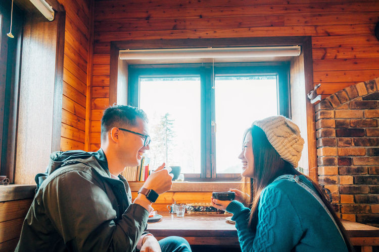 Daisetsuzan Real People Women Sitting Two People Window Lifestyles Togetherness Adult Waist Up Leisure Activity People Indoors  Young Women Men Day Young Adult Table Winter Females Warm Clothing