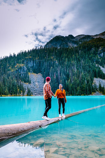 Couple at lake against mountains
