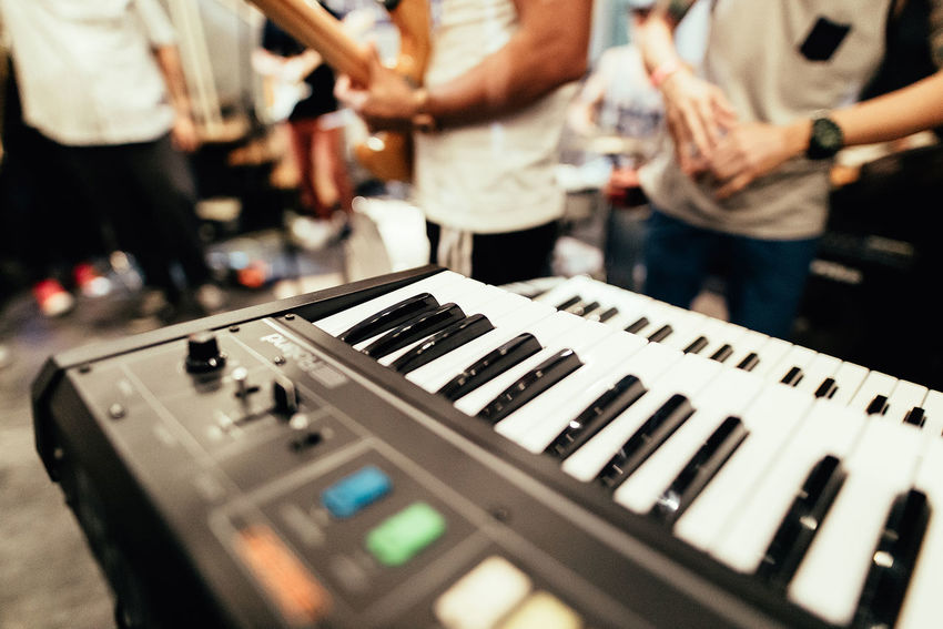 Artist Arts Culture And Entertainment Audio Equipment Focus On Foreground Incidental People Indoors  Keyboard Instrument Men Midsection Music Musical Equipment Musical Instrument Musician People Performance Piano Piano Key Playing Real People Standing