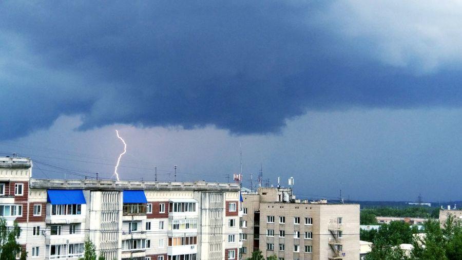 Lightning over buildings in city