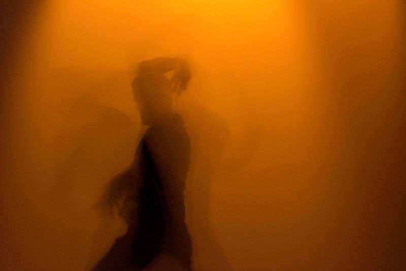 Blurred Motion Of Man Dancing In Museum