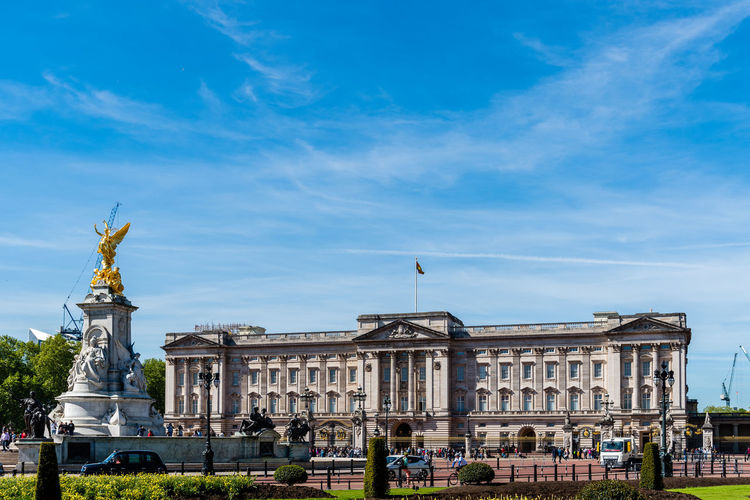 Buckingham Palace a sunny day at springtime Brexit Britain Buckingham Buckingham Palace London Queen Uk Victoria Architecture Blue British Building Capital City Culture Destinations Elizabeth England English Europe European  Famous Gold Guard Historic History KINGDOM Landmark Memorial Monarchy Monument Old Palace People Place Royal Royalty Sculpture Sightseeing Sky Statue Sunny Tourism Tourist Tradition Traditional Travel United Weather Westminster
