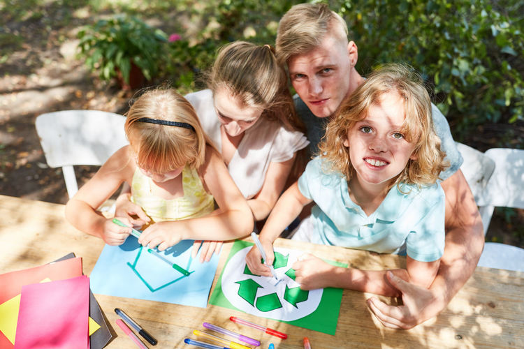 Family making drawing on table