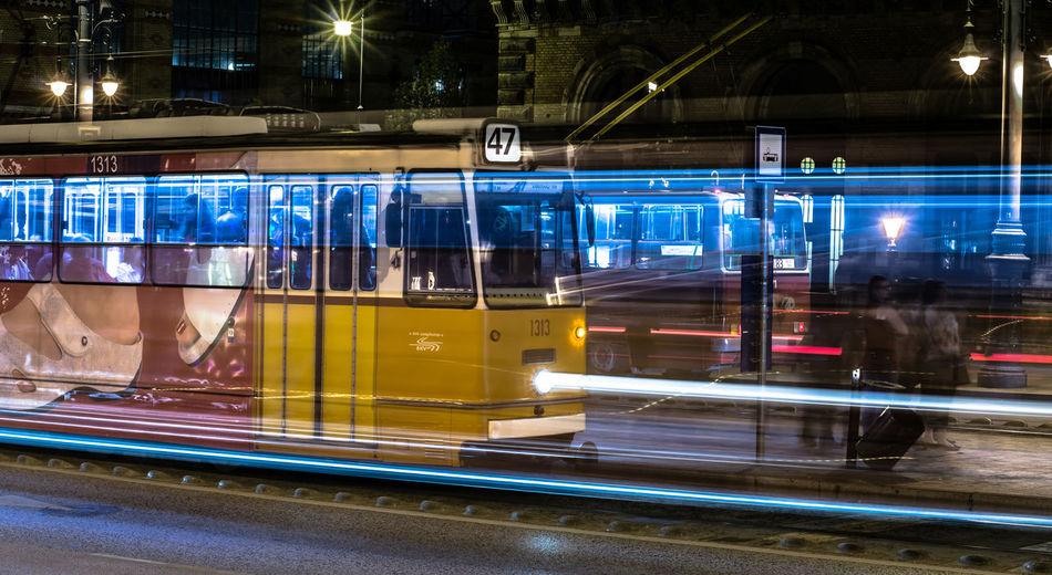 Train on illuminated city at night