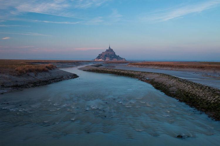 Distant view of mont saint-michel against sky