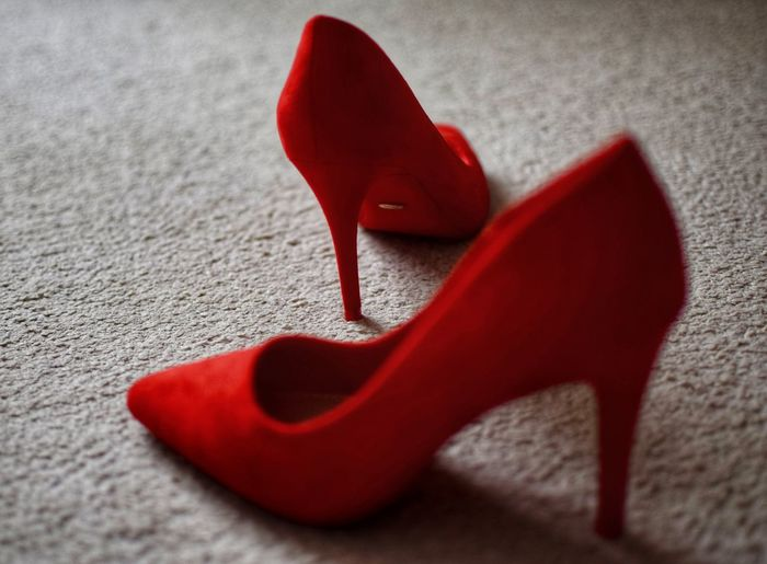 High angle view of red shoes on rug