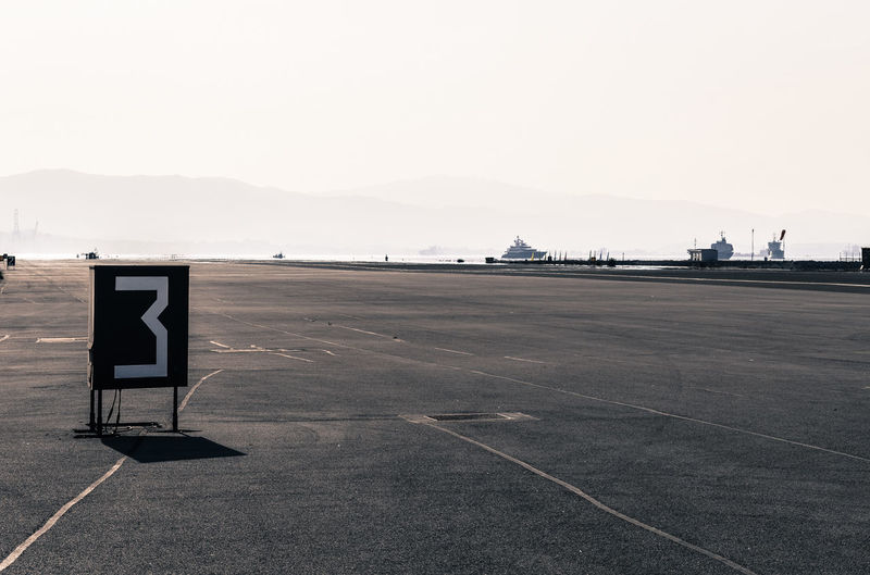 Number At Airport Runway Against Clear Sky