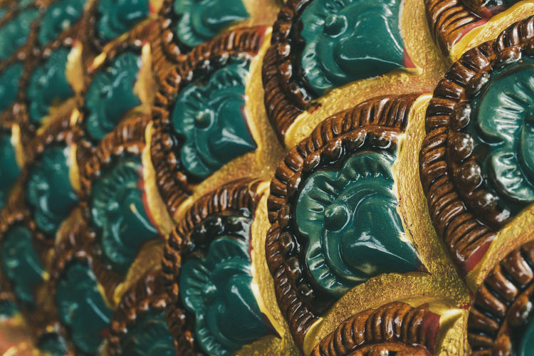 Sculpture pattern of the serpent in Thailand of Thai and Lao cultural beliefs and philanthropy. Serpent Pattern Naga Temple Background Texture King Snake Statue Scale  Buddhist Beautiful Design Green Buddhism Religion Ancient Thailand Abstract Architecture Laos ASIA Beliefs Philanthropy Concept Respect