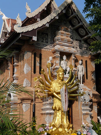 Seem be ONLY a representation statue for cult. Frontage Of A Building In Thailand Warrior Representation Eyeem Best Shot Golden Colors Idol Representation Multi-Arms Spirituality Architecture Building Exterior Golden Statue Human Representation Lot Of Sculture Low Relief Ornate Place Of Worship Religion Temple Day Low Angle View Edited Photography Vertical Photography Eyeem Market EyeEm Best Shots